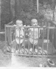230_twins_in_playpen
